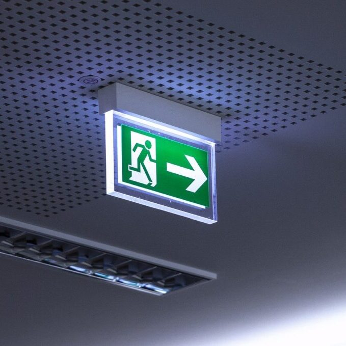 emergency exit sign illuminated on the ceiling